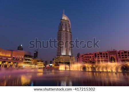 UAE, DUBAI - JANUARY 01: Dubai fountains show at the Dubai Mall on January 01, 2015 - stock photo