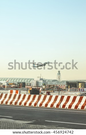 "UBAI, UAE - FEBRUARY 27, 2014: Aircraft take off ""flydubai"" airline in Dubai International Airport - stock photo"