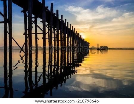 Ubein Bridge at sunrise, Mandalay, Myanmar - stock photo