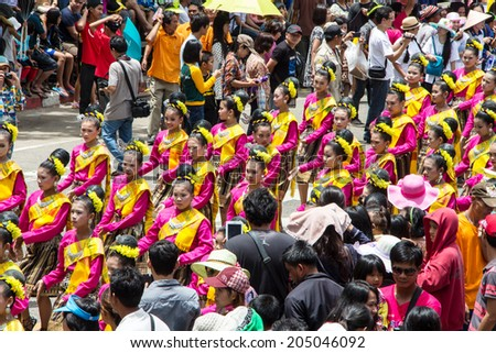 UBON RATCHATHANI, THAILAND - JULY 23: Many people watch beautiful girl dance in Candle Festival (Ubonratchathani Candle Festival 2011) on July 12, 2014, UbonRatchathani, Thailand
