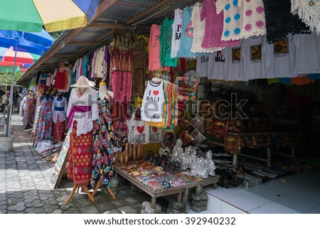 UBUD, BALI - MARCH 14, 2016: Souvenir items from art, handicraft to shirts are for sale on at the souvenir market in Pura Tirta Empul (temple), Bali.  - stock photo