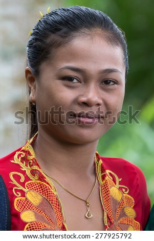 UBUD, INDONESIA - FEBRUARY 18, 2015 : Portrait of an unknown young Balinese girl in national dress - stock photo