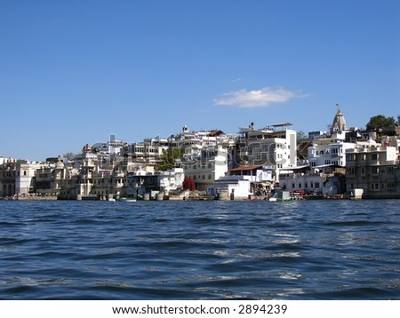 Udaipur city from the Lake Pichola - stock photo