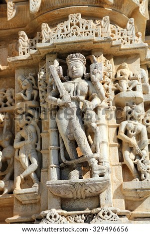 UDAIPUR, INDIA - NOVEMBER 25, 2012: sculpture on hinduism ranakpur temple in rajasthan india - stock photo