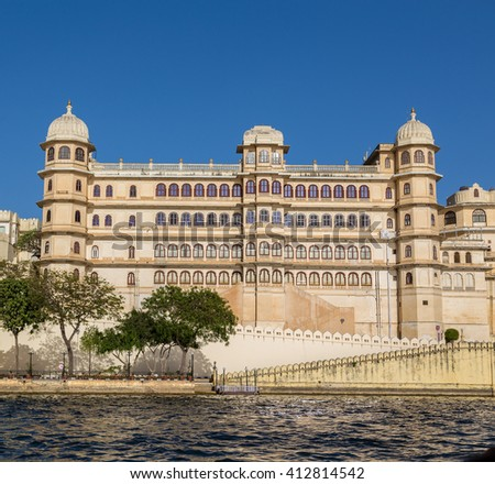 UDAIPUR, INDIA - 20TH MARCH 2016: Part of the city palace in Udaipur during the day from the lake.