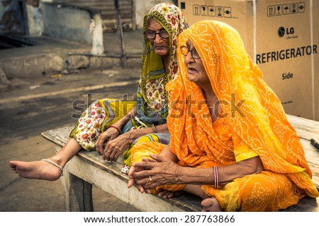 UDAIPUR, RAJASTAN / INDIA - MAY 27 2013 - Two Unidentified old women sitting on the streets of Udaipur. - stock photo