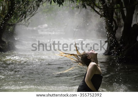 Udon Thani Province, Thailand - November 8: Traditional bathing in a river on November 8, 2015, in Udon Thani Province, Thailand.