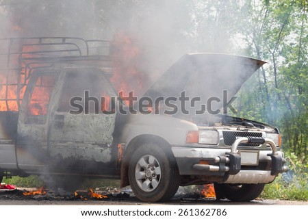 UDONTHANI-MARCH 14,2015:Car on fire after short circuit on the Highway between SAKHONAKHON-UDONTHANI road.Udonthani thailand 14 march 2015