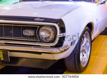 UDONTHANI, THAILAND - AUGUST 19, 2015:  White Chevrolet Camaro 327 car at the ISAN mini motor show 2015 on August 19, 2015 in Udonthani, Thailand - stock photo