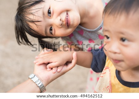 UDONTHANI THAILAND-OCTOBER 5 2016:Cute baby Asia smiling in teamwork  success
