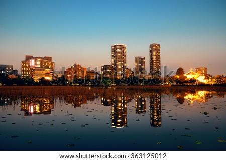 Ueno park in Tokyo at night with lake reflection, Japan. - stock photo