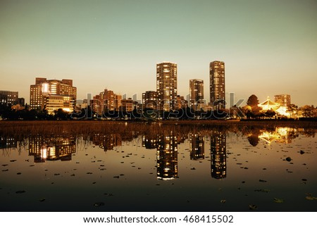 Ueno park in Tokyo at night with lake reflection, Japan.