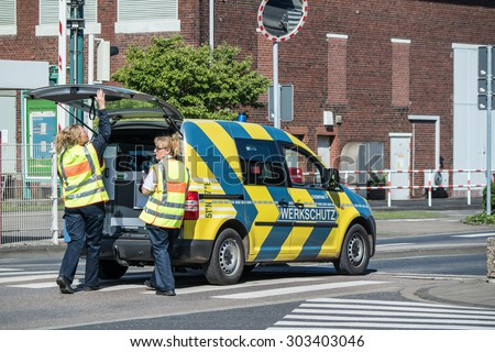 UERDINGEN, KREFELD / GERMANY - AUGUST 05 2015: Plant security arriving short after the explosion in Chempark Uerdingen
