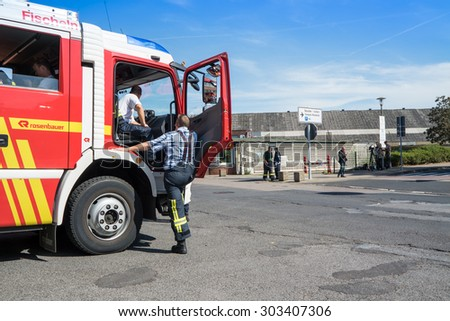 UERDINGEN, KREFELD / GERMANY - AUGUST 05 2015: Rescue forces arriving short after the explosion in Chempark Uerdingen