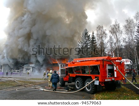 "UFA, BASHKORTOSTAN, RUSSIA - NOVEMBER 3: Bistro ""Violet smog"" burns with black smoke and heavy flames on November 3, 2010 in Ufa, Bashkortostan, Russia. - stock photo"
