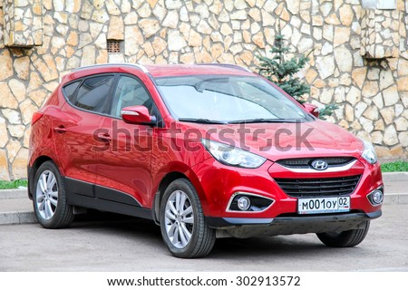 UFA, RUSSIA - APRIL 24, 2012: Motor car Hyundai ix35 at the city street. - stock photo