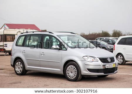 UFA, RUSSIA - APRIL 19, 2012: Motor car Volkswagen Touran at the used cars trade center. - stock photo