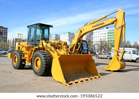 UFA, RUSSIA - APRIL 14, 2008: Yellow LiuGong 856 front end loader at the city street. - stock photo