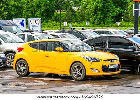 UFA, RUSSIA - JUNE 8, 2013: Motor car Hyundai Veloster in the city street. - stock photo