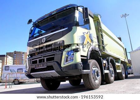 UFA, RUSSIA - MAY 28, 2014: Green Volvo FMX dump truck exhibited at the annual Autosalon Motor show.