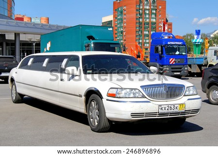 UFA, RUSSIA - MAY 22, 2012: White limousine Lincoln Town Car at the city street. - stock photo