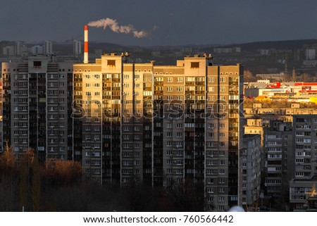 Ufa, Russia October 20, 2017: evening cityscape. Some houses are brightly lit by the rays of the setting sun.