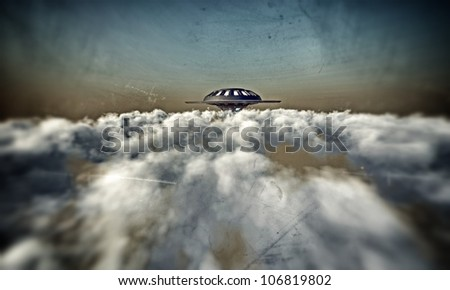 UFO flying in a dark sky - stock photo