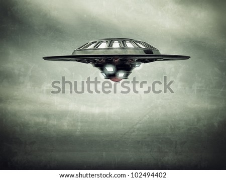 ufo spaceship vessel flying in cloudy sky - stock photo