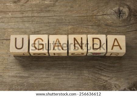 Uganda on a wooden background - stock photo