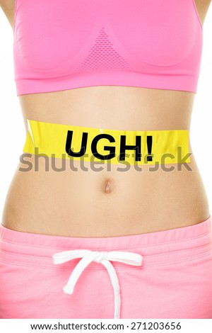 UGH my stomach hurts concept - girl with belly problems. Word written on yellow sign on female lower body to show abdomen pain or digestion issues, cramps or bloating, muscle ache. - stock photo