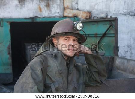 Uglegorsk, Ukraine - March 12, 2014: Miner mine Uglegorskaya near empty trolley - stock photo