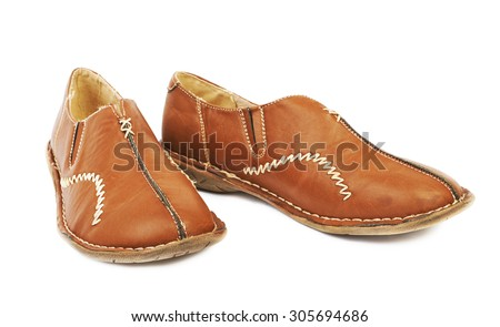 Ugly leather shoes for women isolated on white - stock photo