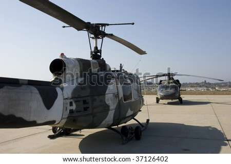 UH-1 Huey and UH-60 Helicopters - stock photo