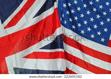 UK and US flags together symbolizing coalition, peace and joint forces - stock photo