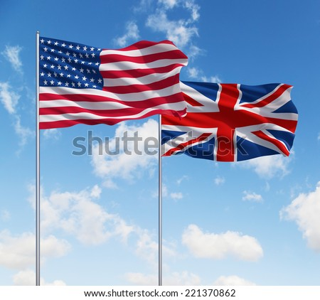Uk and USA flags on a blue sky background. - stock photo