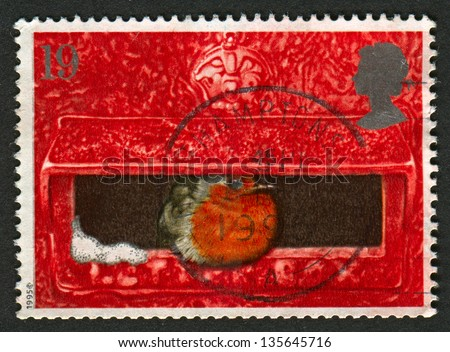 UK - CIRCA 1995: A stamp printed in UK shows image of The European Robin in Mouth of Pillar Box, circa 1995.
