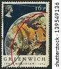 UK - CIRCA 1984: A stamp printed in UK shows image of the View of Earth from Apollo 11. Centenary of Greenwich Meridian, circa 1984. - stock photo