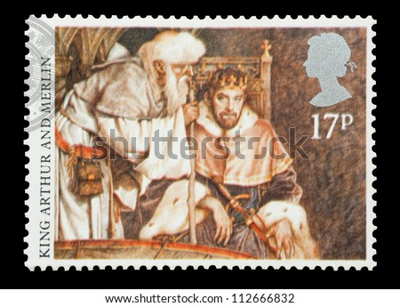 UK - CIRCA 1985: Mail stamp printed in the UK featuring the Arthurian Legend; King Arthur and Merlin, circa 1985 - stock photo