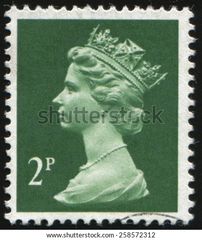UK-CIRCA 1971:postage stamp printed in United Kingdom shows Queen of England - Queen Elizabeth II. Profile in the crown on a green background., circa 1971. - stock photo