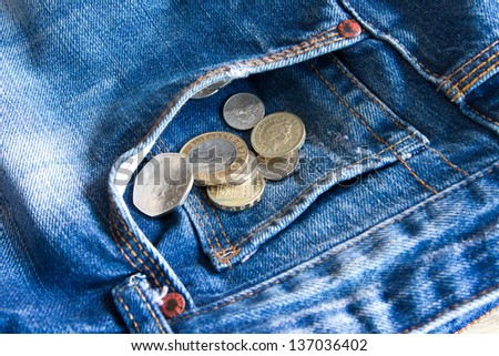 UK coins falling out of jeans pocket - stock photo