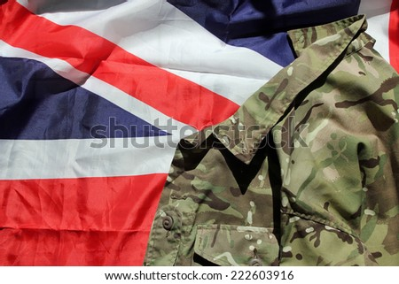 UK flag and military uniform depicting the military, war and conflict  - stock photo
