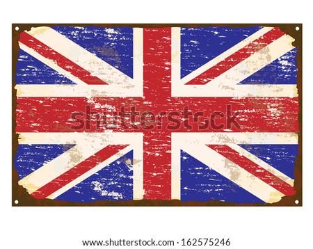 UK flag on rusty old enamel sign  - stock photo
