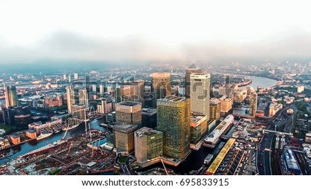 UK, LONDON - SEPTEMBER 03, 2016: Aerial Image Photo of London City Financial District Skyscrapers in Canary Wharf Helicopter Flight View with Sunrise Skyline Around the Business Buildings UK