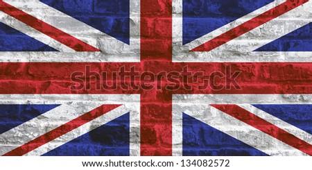 UK national flag - Union Jack on stone wall background - stock photo