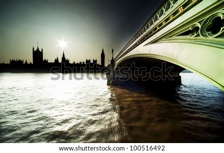 UK Parlement silhoutte  and bridge - stock photo
