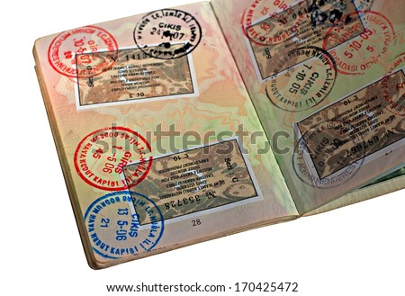 UK passport with Turkish visitor visa's isolated on white background - stock photo