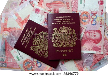 UK passports on Chinese yuan - stock photo