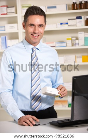 UK pharmacist at work - stock photo