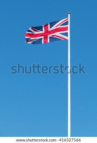 UK Union flag of Great Britain long flagpole.