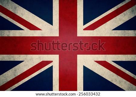 UK, United Kingdom flag on concrete textured background - stock photo